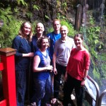 Photo of the Japan trip group in front of a shrine and waterfall in Seki, Japan.